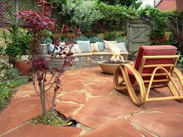 the good shape of flagstones patios. A Burgundy-leafed Tree And Red Cushions Complement This Flagstone Patio By Urban Oasis. The Good Shape Of Flagstones Patios