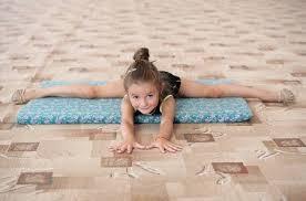 floor gymnastics splits. Simple Gymnastics Little Girl Doing Legsplit On The Floor Gymnastics For Young Females  Stock Photo Throughout Floor Splits N