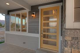 front door companyContemporary Front Door with exterior stone floors by Candlelight