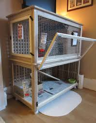 a 2 level rabbit cage ed from the ikea hol storage boxes
