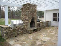 concrete outdoor kitchen with fireplace