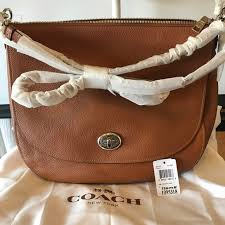COACH Turnlock Hobo in Saddle Tan Pebble Leather