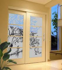 asian tree design sandblasted onto transpa frosted glass doors