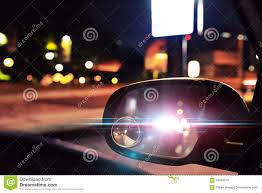 Cop Lights Rear View Mirror Police Car Lights Reflected On The Rearview Mirror Of A