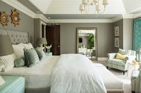 while upholstered chairs and aqua painted nightstands adds a touch of cheer to the space the wall color is benjamin moore winter gates