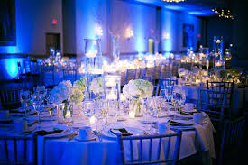blue and silver decorations wedding ceremony with large round table white flower centerpieces also small wooden