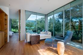 floor to ceiling glass walls provides views of the surrounding landscape from this modern