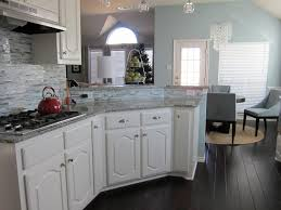 White Kitchen Cabis With Hardwood Floors Dark Countertops Dark