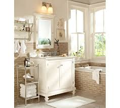 double light bathroom sconces over white vanity with wall mirror frame beside rectangle bathtub