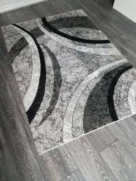 hard back black grey white rug juniper green