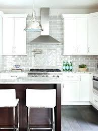dark gray backsplash white cabinets for ice granite in a kitchen with grey tile black