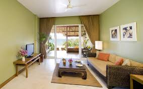Living Room:Extraordinary Tropical Living Room Decoration With L Shaped  White Sofas Tropical House With