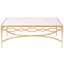 unique brass base coffee table design with white marble top and tapered brass table legs