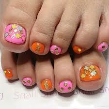 pink orange and gold toe nail design