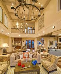 chandeliers great room chandelier height chandelier high ceiling living room contemporary with decorative pillows wall