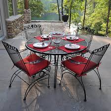 black wrought iron furniture. furniture round black wrought iron table with four chair using arm and carved back having red upholstered seat out door outdoor metal n