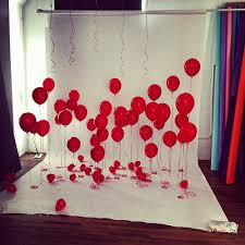 red balloons on white backdrop