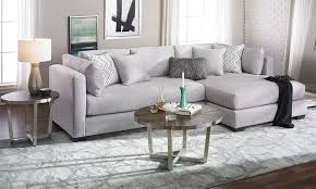 oversized parker contemporary sectional sofa in silver upholstery with accent pillows in living room