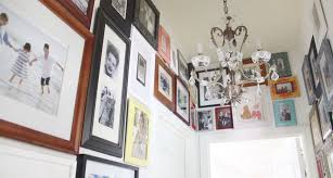 i ve practically wallpapered our hallway with family photos both young and very old i even went up over the door frames and into the corners pre made