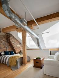 Modern Industrial Bedroom Exposed Brick Wall Accent And Sloping Ceiling Design For Modern