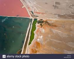 atlantic salt works aerial view of saline water at the salt works of walvis bay between