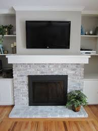 painting brick fireplace with sponge