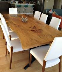 custom made bookmatched live edge sycamore dining table