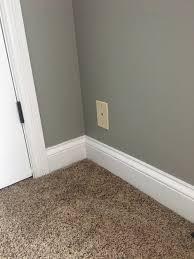 gray paint brown carpet