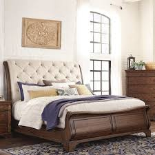 Home furniture bed designs 10 Bed Trisha Yearwood Home Collection King Sleigh Upholstered Bed In Coffee Beds Nebraska Furniture Mart Beds Nebraska Furniture Mart