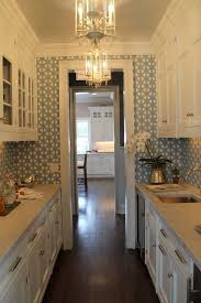 narrow kitchen design with chandelier to give a romantic lighting