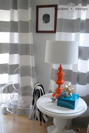 lovely grey horizontal striped curtains plus cute table lamp in white side table for interior design