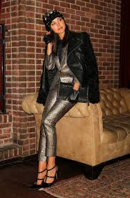 metallic silvery tuxedo suit is worn underneath black leather jacket with sheepskin sleeves