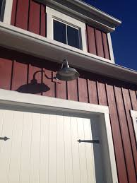 red farmhouse with galvanized barn lights from barnlightelectric com