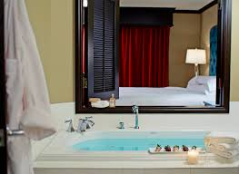 Orlando Room Accommodations Grand Bohemian Hotel - Bathroom with jacuzzi and shower