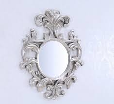 fascinating round decorative wall mirrors with stunning frame carving design