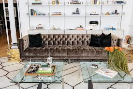 this classic velvet couch works wonderfully with the more modern white bookshelves and glass coffee table