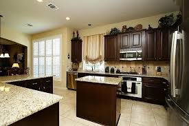 image of dark cabinets light countertops and flooring
