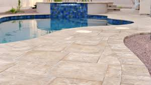 custom swimming pool decks with natural stone and tiles