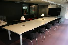 large office tables. Interior. Rectangle White Meeting Table And Black Chairs With Stainless Steel Legs On The Floor Large Office Tables R