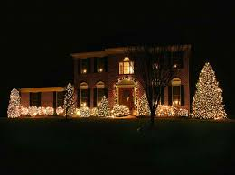 christmas house lighting ideas. fabulous outdoor christmas lighting designs with two story house design brick walls and white wooden framed windows also black covers plus lush ideas