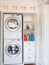 double stack washer and dryer. Lewis And Weldon: Hidden Laundry Closet With Stackable Front Loading Washer Dryer Built-in Storage . Double Stack B