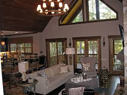 small cabin home plan vaulted open living room