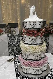 wedding cakes with lights. Brilliant Wedding Multi Layered Wedding Cake With Bridal Figurines And Fairy Lights Stock  Photo  6879347 For Wedding Cakes With Lights C