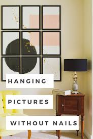 In this blog post I'm showing you exactly how to hang pictures without nails