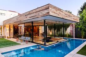 this australian home features a small lap pool in the backyard and a sunken living room