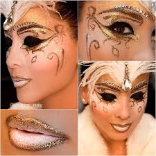rhinestone accented eye brows highlight a sparkly gold masquerade makeup mask