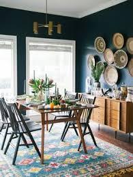 earthy festive modern dining room via dabito dining room rugs