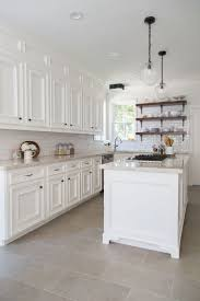 White Kitchen Cabinets With Subway Tiles For Backsplash And