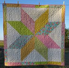 Lovin' Life At The End Of The Dirt Road: Lone Star Baby Quilt Finished & You can find her free tutorial here: Lone Star Baby Quilt Tutorial . This  is now my 'Go To