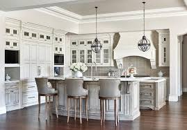 gray wash curved kitchen island breakfast bar with gray leather counter stools